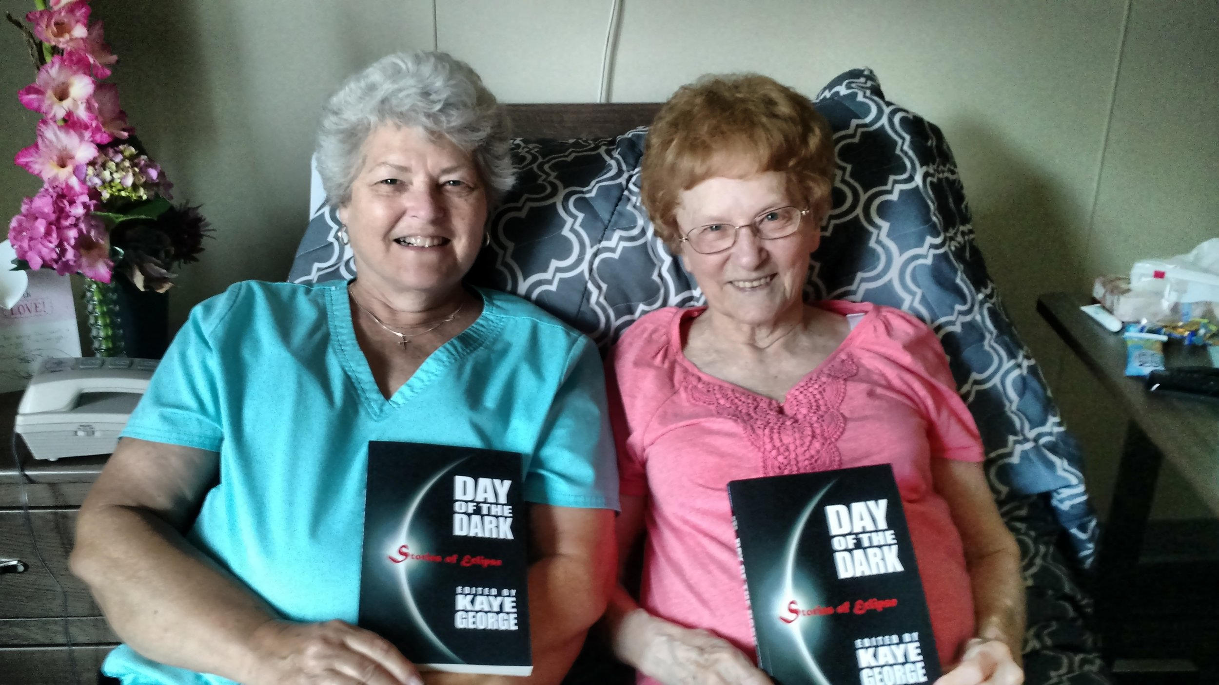 My mom and grandma with their copies. Speedy recoveries for grandma who just had back surgery.