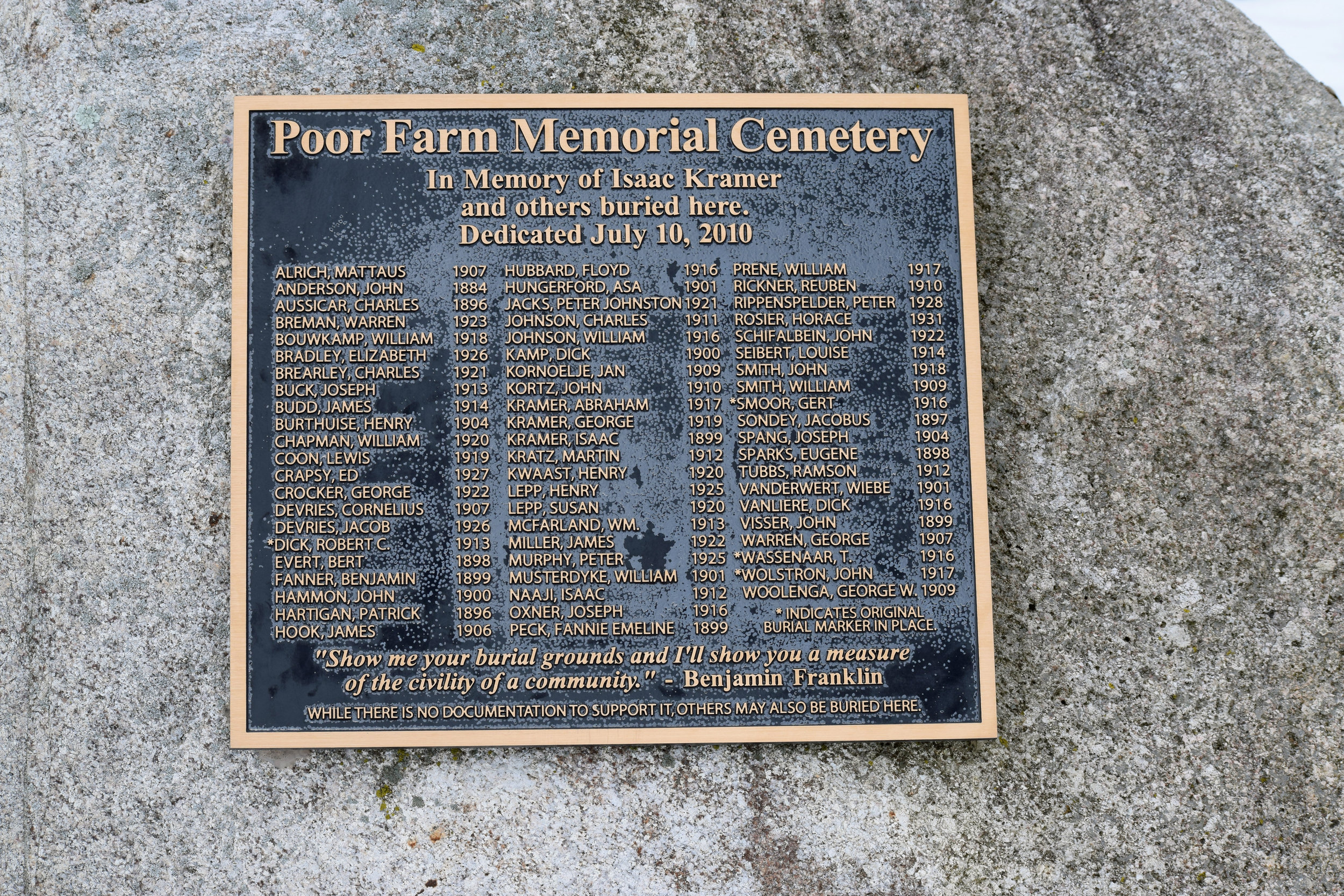 Sign at the Poor Farm Memorial Cemetery with a list of those buried in the cemetery.