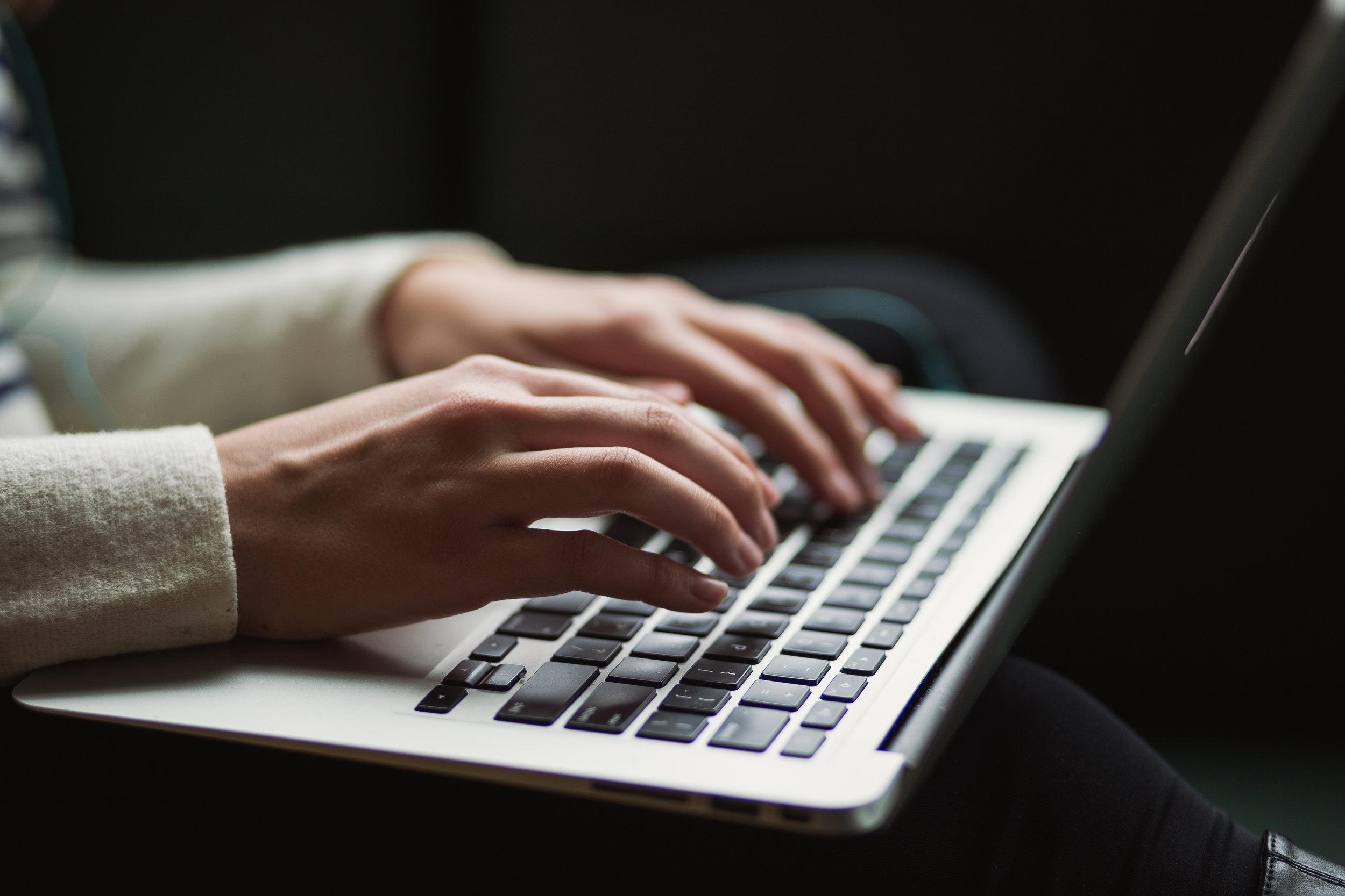 Woman's hands on a laptop keyboard