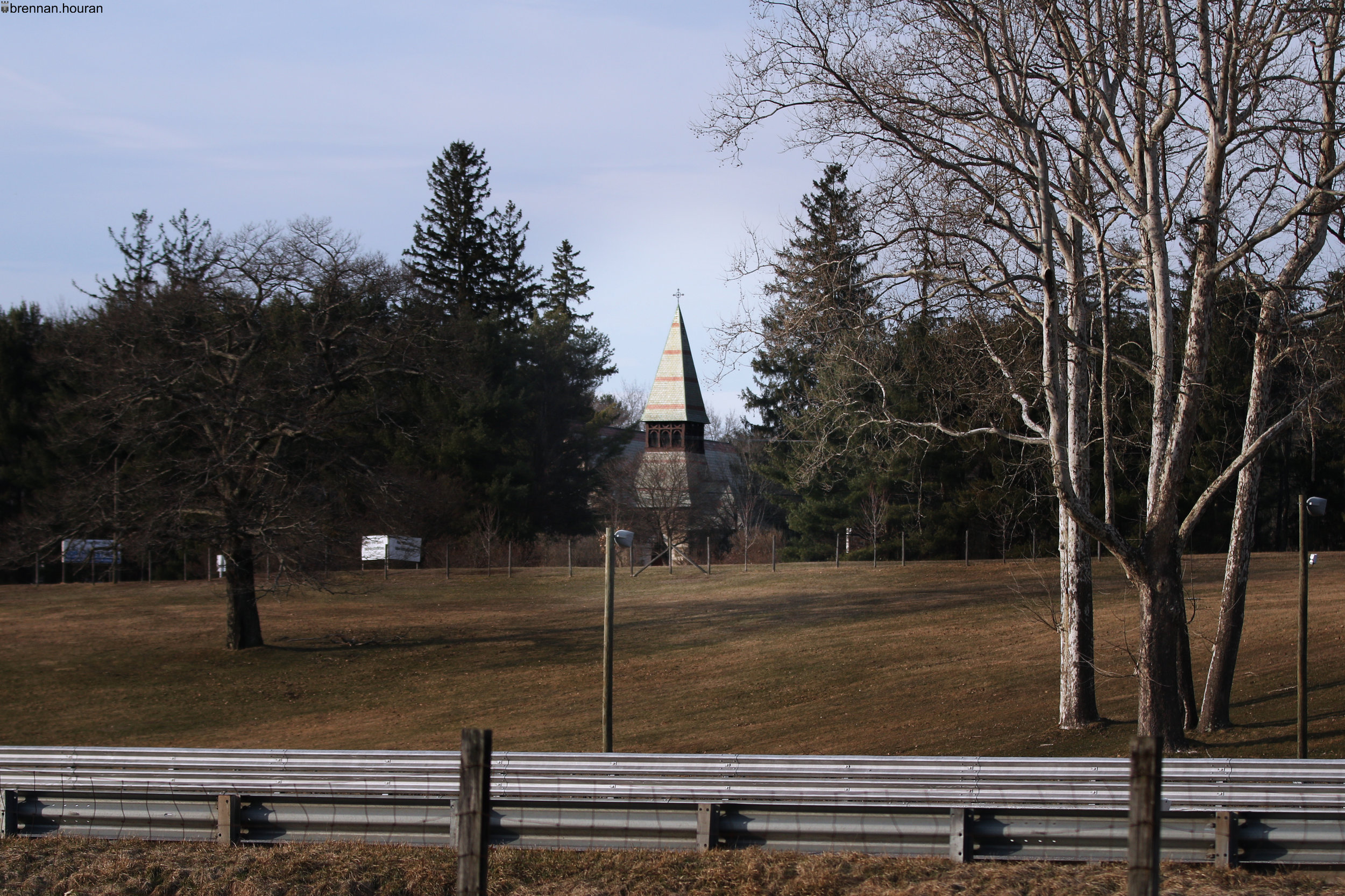 Above:    The Trinity Lime Rock-Trinity Episcopal Church seen from Lime Rock Park's main paddock.