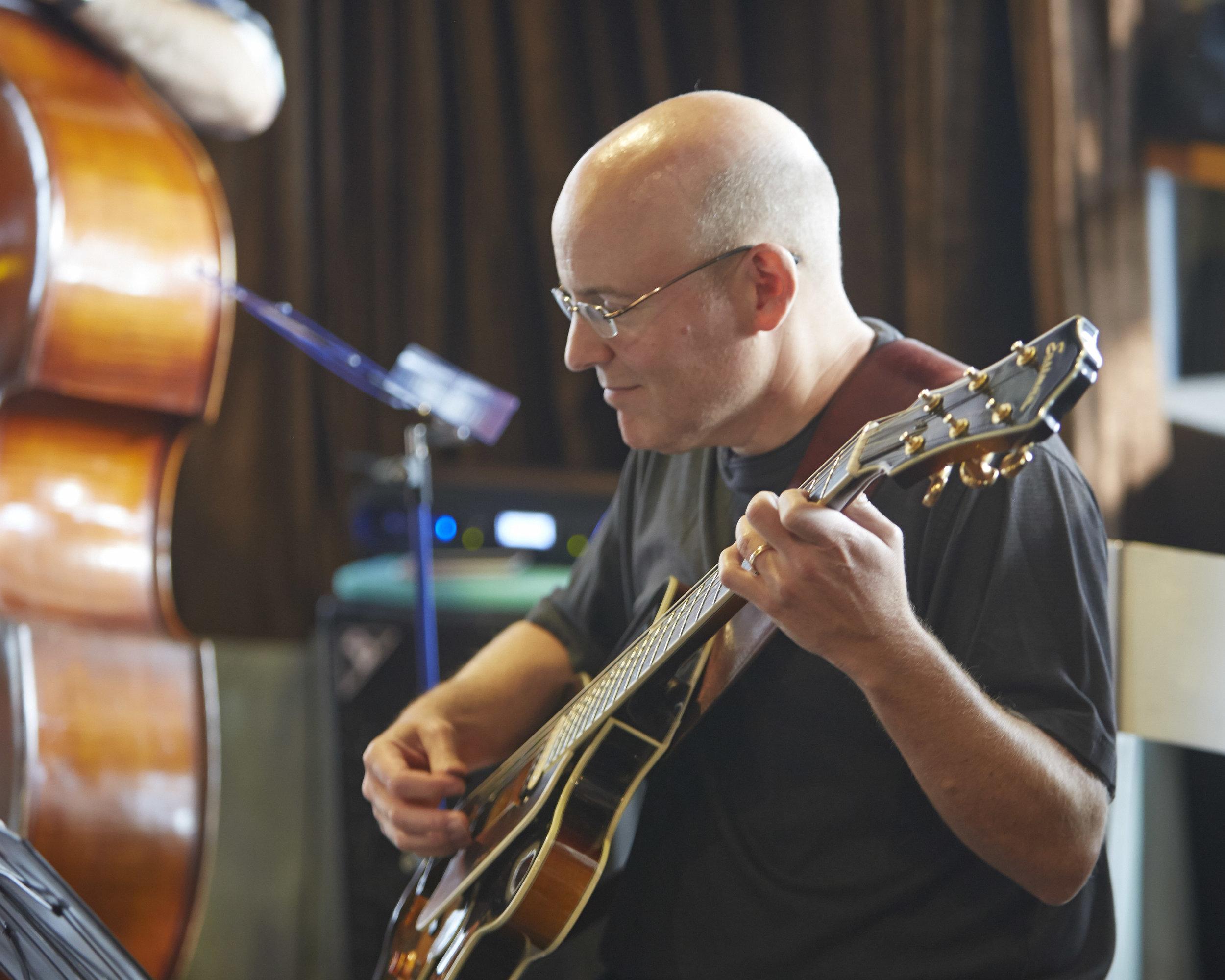 Bob Sneider, guitar