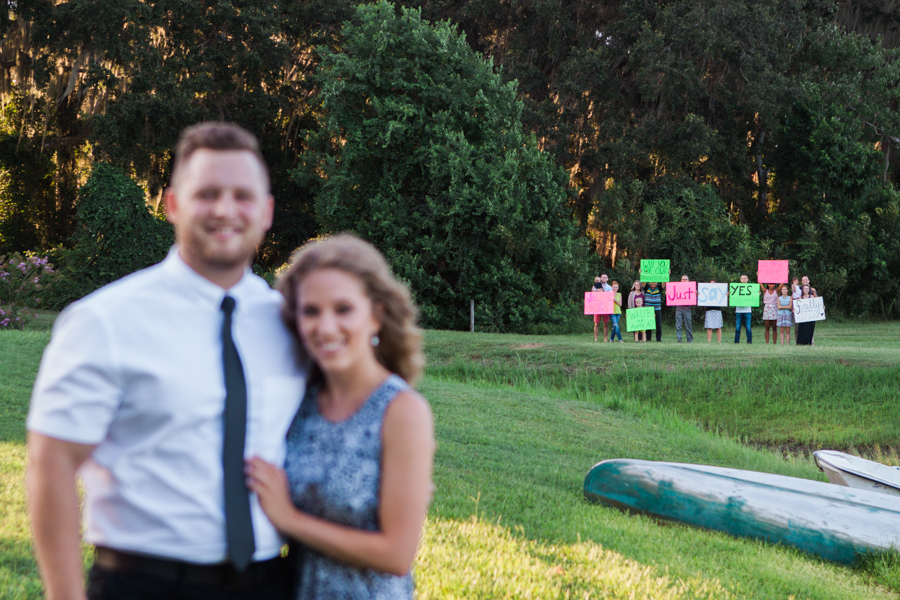 I walked up to Amber and showed her this picture. She was confused for a second wondering what kind of weird people would be at our photo shoot until she saw the words on the signs!