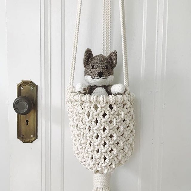 How adorable is this little guy from @softly_made hanging out in his macramé basket!?