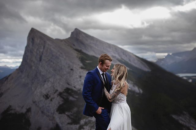 Their first date was a crazy adventure up ha ling peak, so what better place to take their wedding photos🗻🖤 • • • • • • • • • • #calgaryweddingphotographers #canmorewedding #albertabride #yycbrides #calgarybride #yycbride #yycwedding #yycweddings #yycweddingphotographer #calgaryweddingphotographer #calgarywedding #calgaryphotographers #calgaryphotography #calgaryweddings ⠀ #weddingphotography #weddingphotographer #weddingideas #weddingday #bridalphotographer #weddingphoto #weddingstyle #weddingmoments #weddinginspo #weddingdetails #weddingplanning #destinationweddingphotographer #destinationwedding #intimateweddings #intimatewedding #realwedding