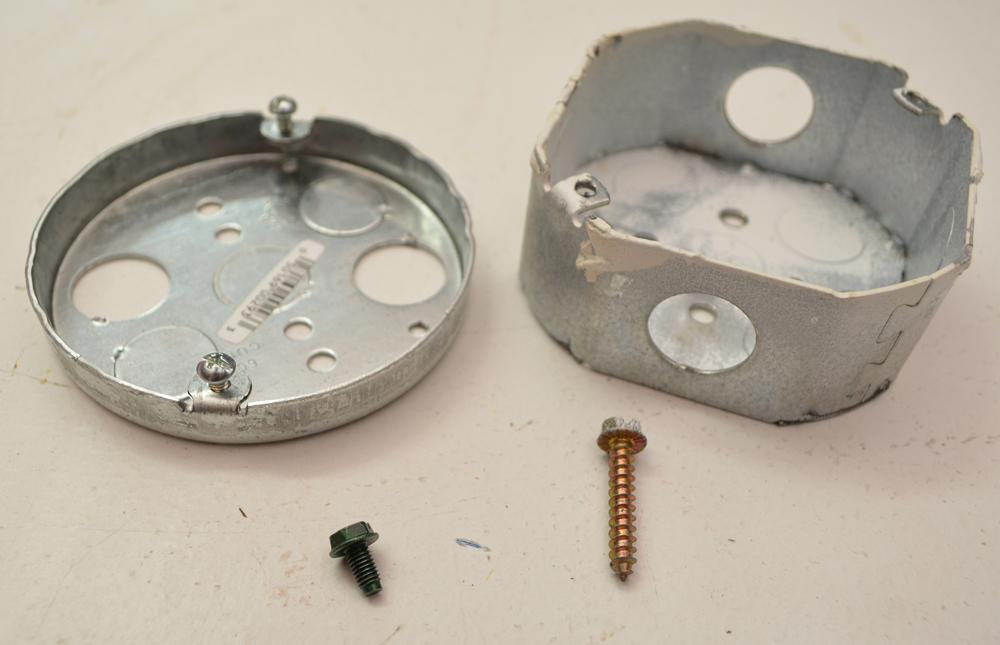 From Left: A Proper Grounding Screw and an Idiot's Coarse-Threaded Grounding Screw (attempt)