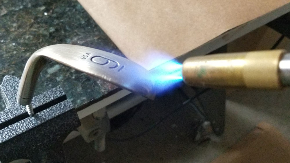 Torch heating a 9 iron