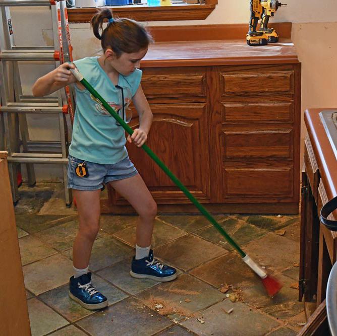 Girl_sweeping_remodeling-kitchen.jpg