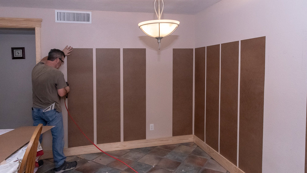 installing-hardboard-to-smooth-walls.jpg