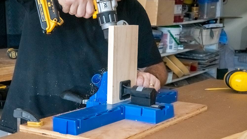 The Kreg K5 Pocket Hole Jig  screwed to a piece of plywood