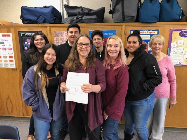 Becky Beckett, Chaparral High School Principal, is joined by her Science Students and staff as she receives her notification letter of a grant from the Ojai Education Foundation to fund science supplies for the 2019 - 20 School Year.