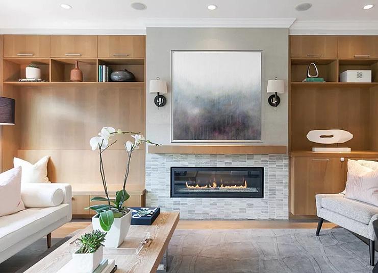 custom Donna Giraud art above fireplace