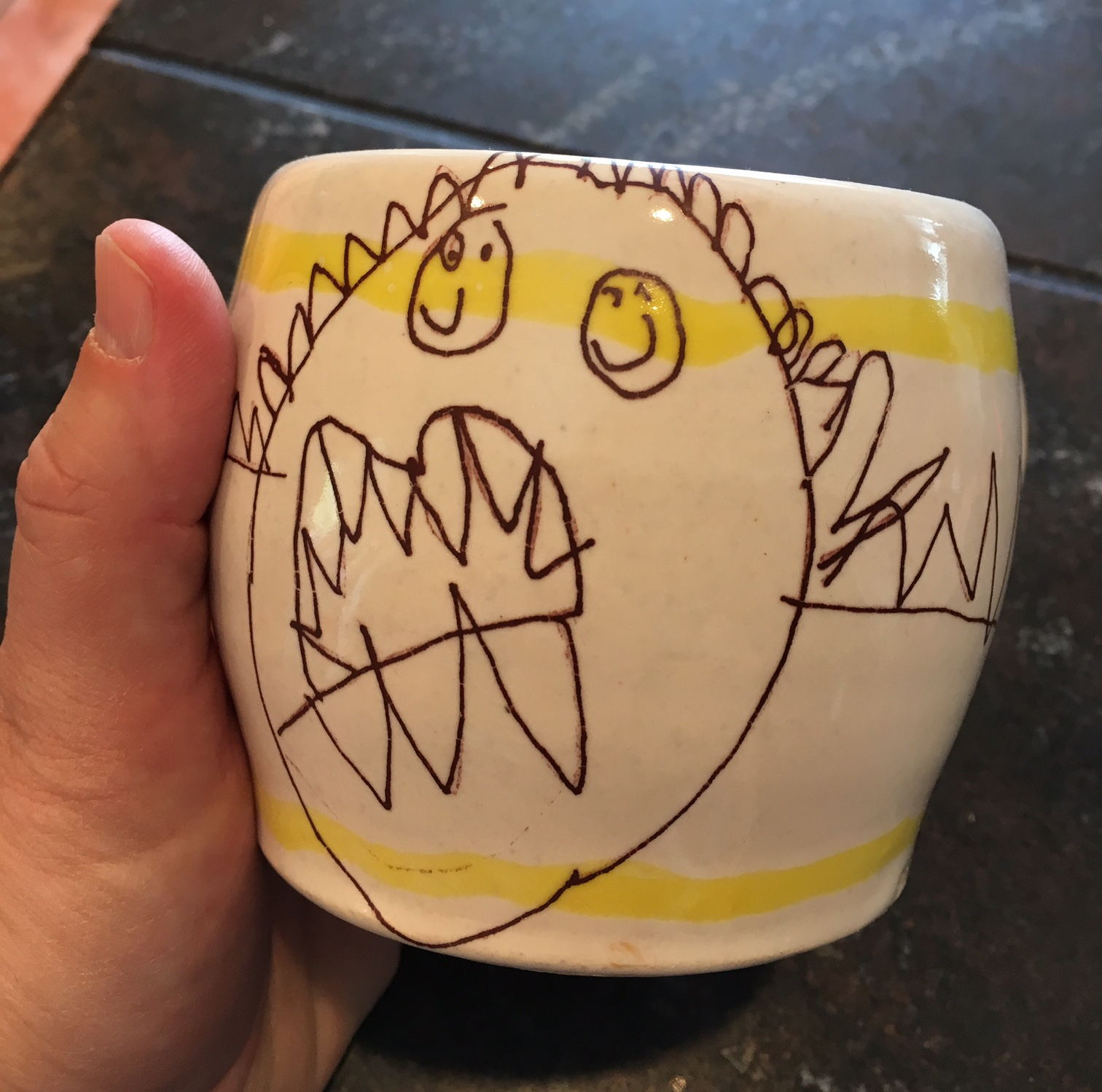 An example of a kid's drawing converted into a decal (food,  dishwasher, microwave safe) and fired onto a pottery mug.