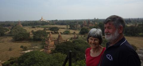 Trevor and Carolyn Monson with Buddist temples and shrines in the background – Bagan, Myanmar