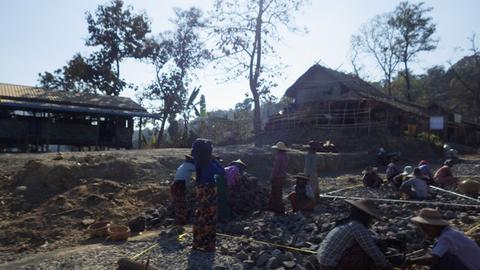 The villagers lay broken rocks between strings
