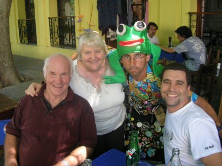 Bruce, Lynn Enrique and a waiter in Colonia