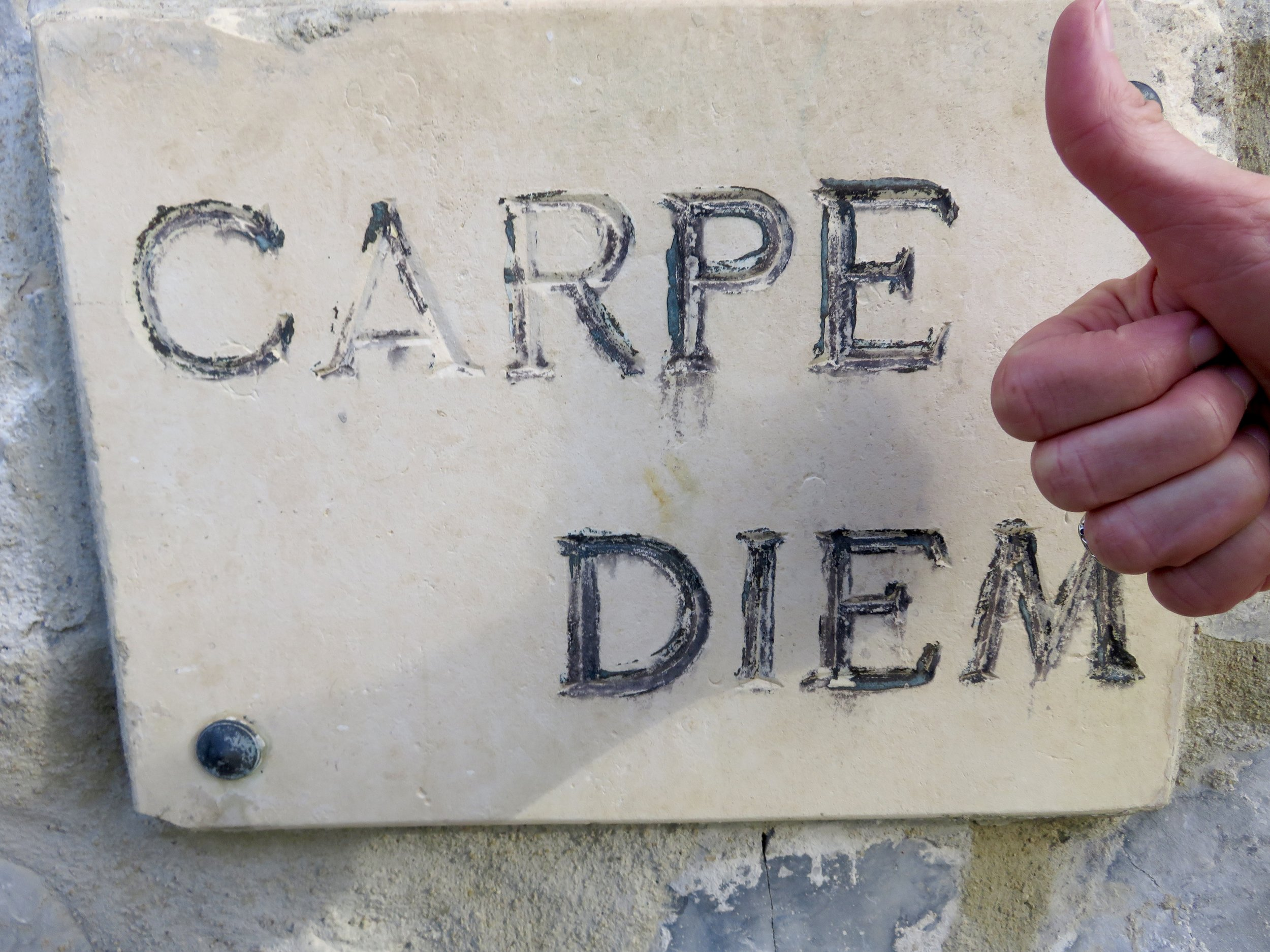 """Carved cornerstone of our home away:  Oui...""""Seize that damned day!"""""""