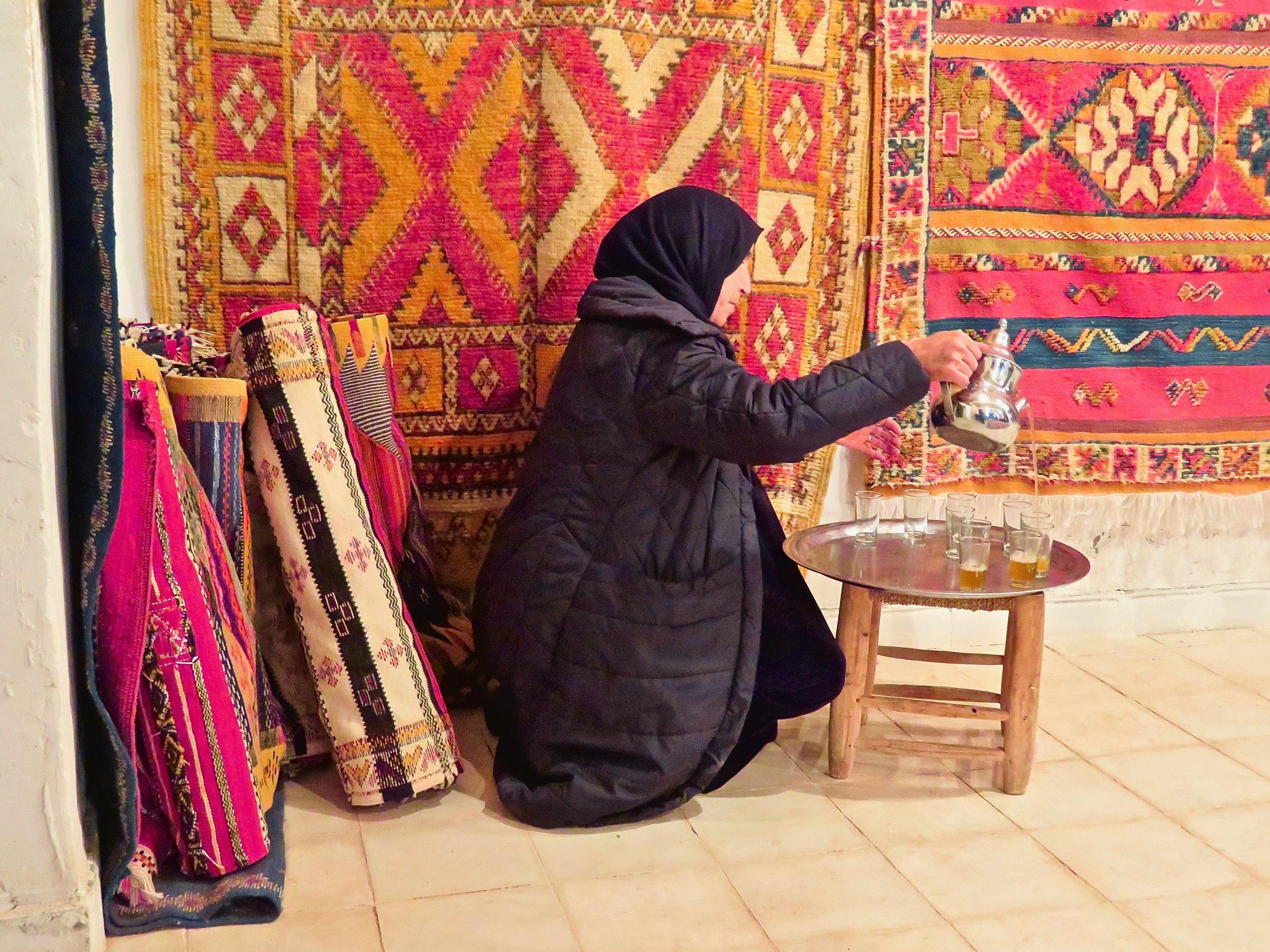 Pouring mint tea, a ritual at any good rug merchant's shop...