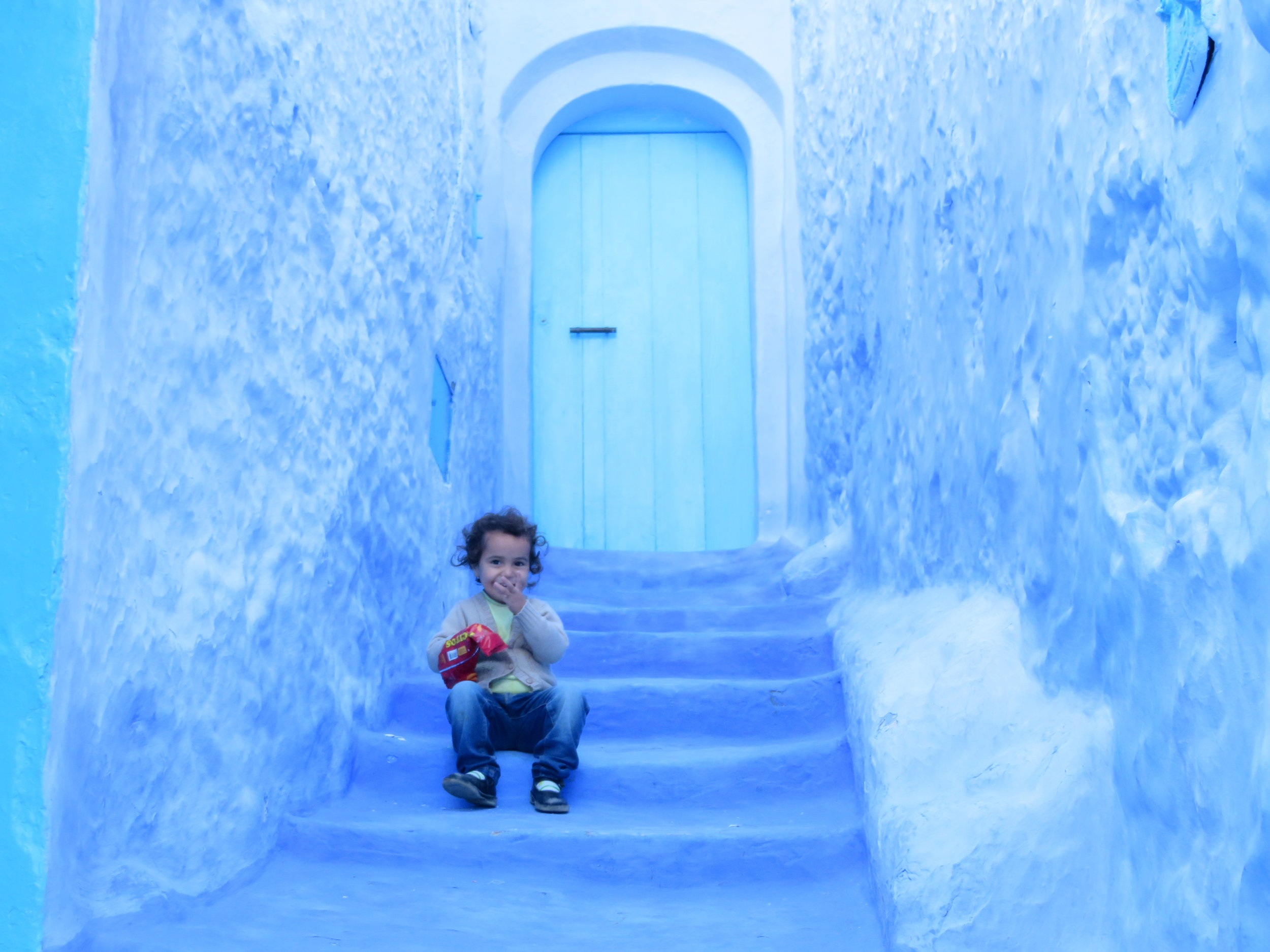 """My little, photogenic friend in the medina of Chefchaouen, the """"Blue City"""""""