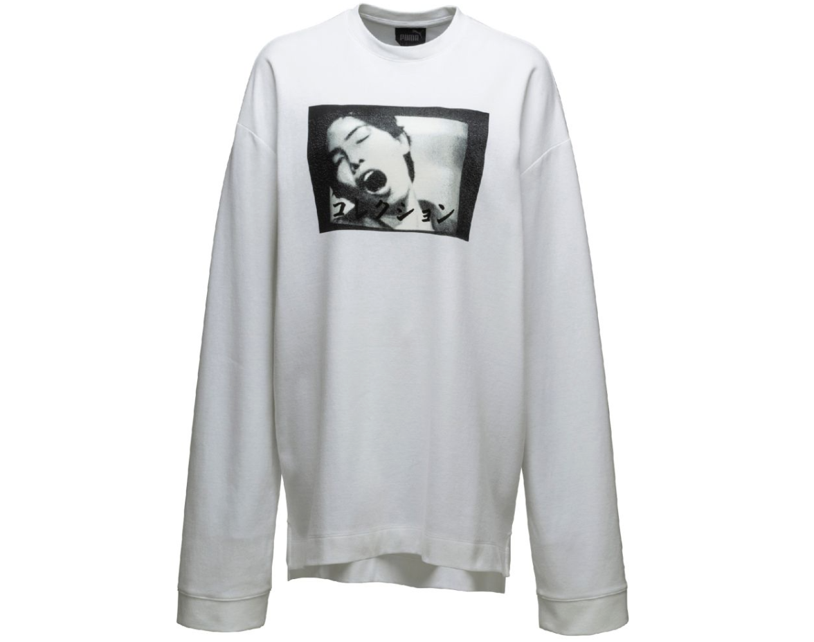 Hitoshi Nomura artwork paired with the collection's lucky number 13 on the sleeves of this  sweater