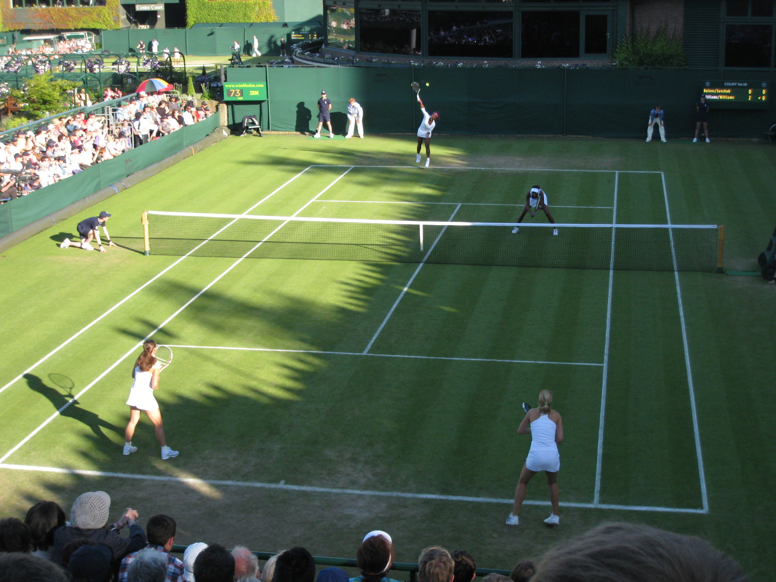 Watch Tennis - See some of the best players in the world on the best courts in the world, up close and personal!(Picture: Williams Sisters playing doubles on court 18)