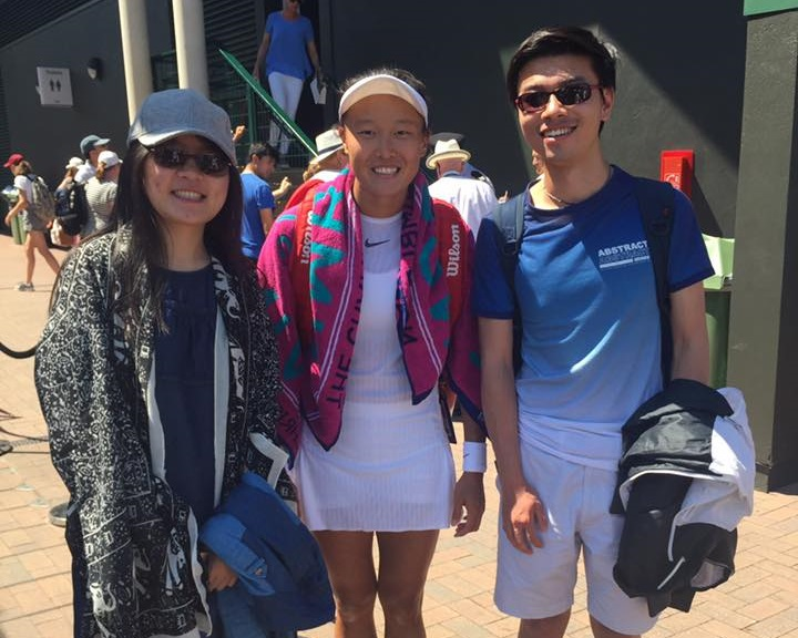 Get close to the players - You will see players walking past you and can go and get autographs at the practise courts.(Picture: Taiwanese doubles star Kai-Chen Chang with two students from the Cafe)