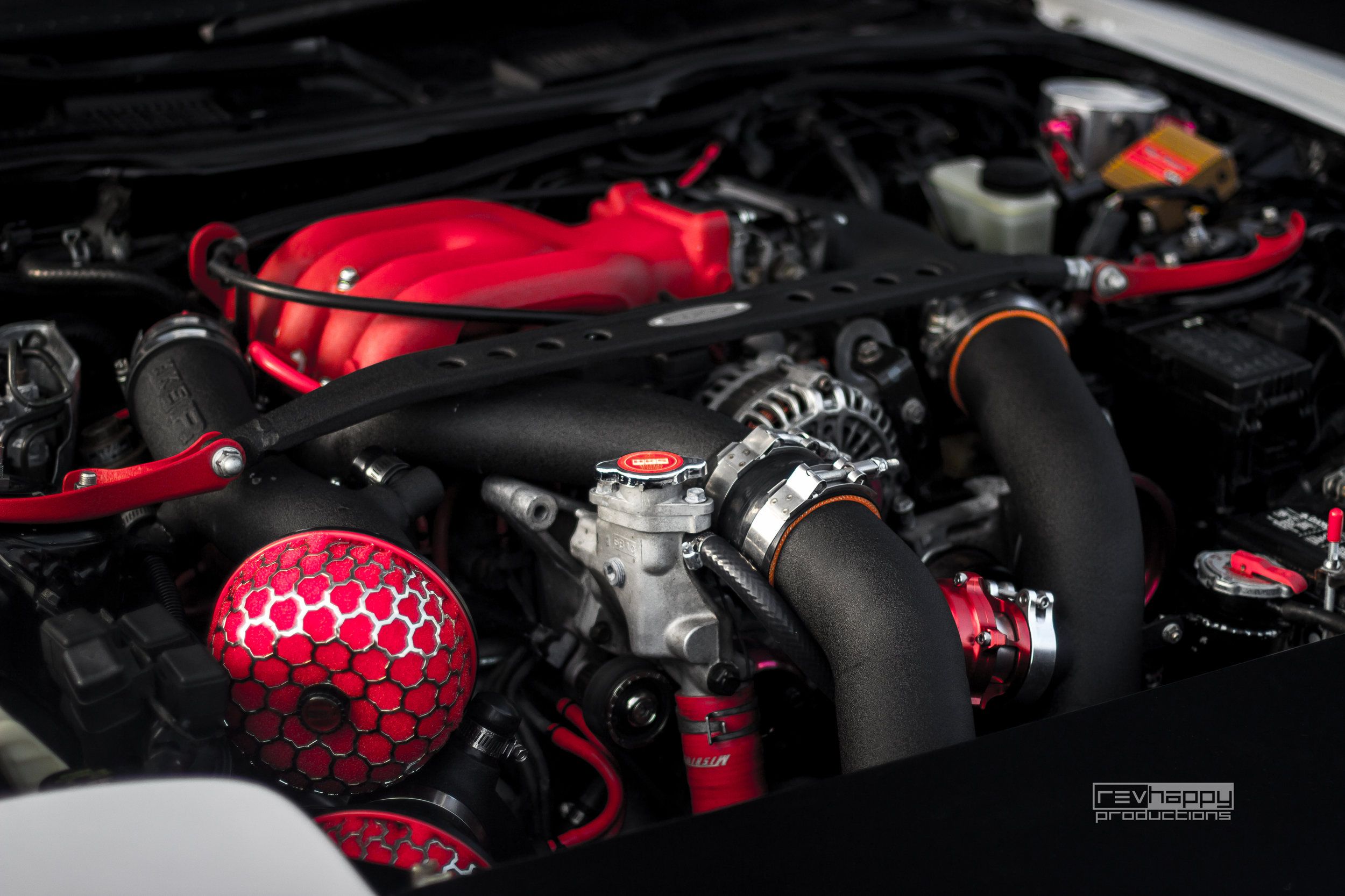 Two turbos, lots of red, and lots of go-fast parts.
