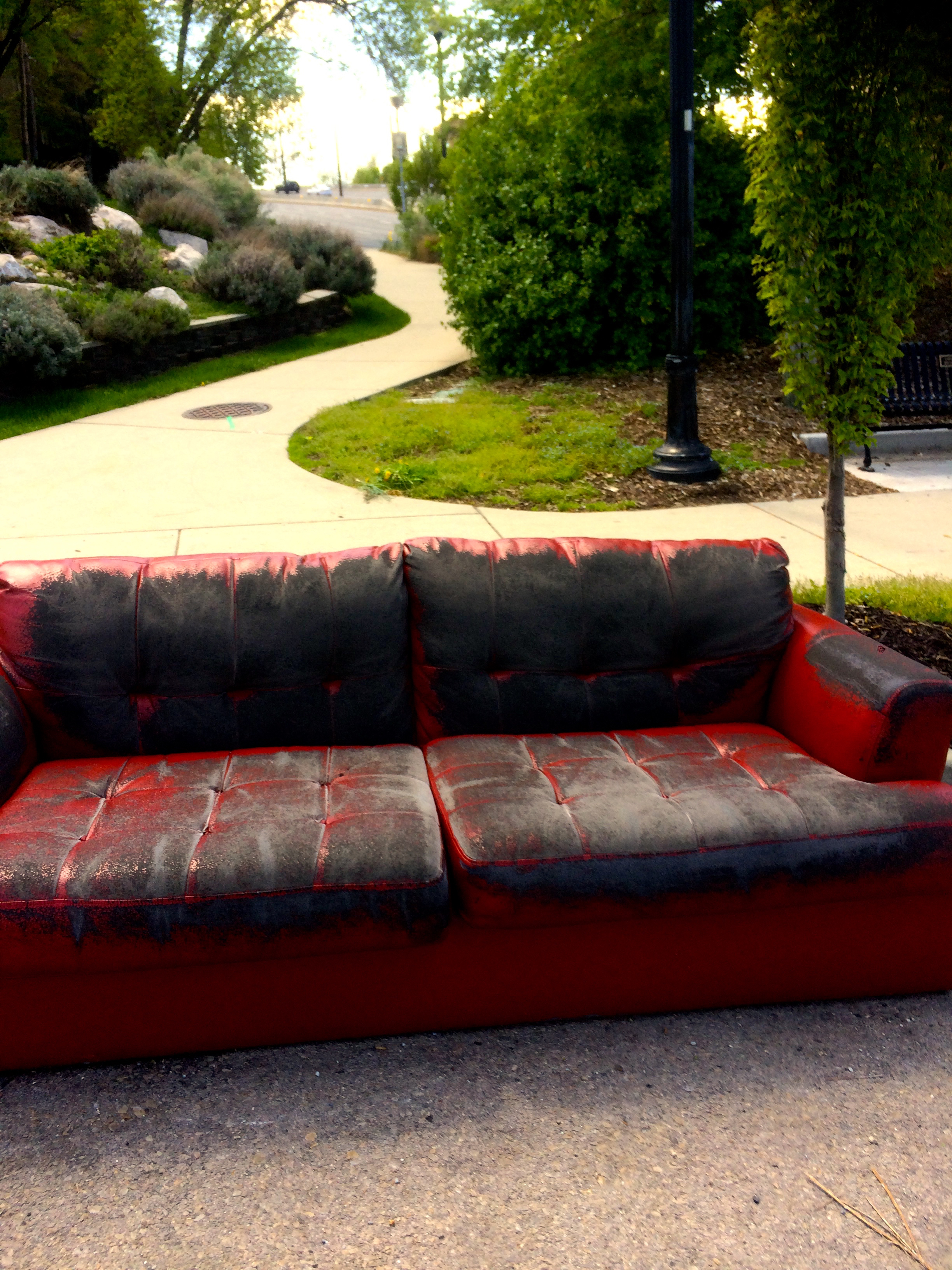Red_Leatherette_Sofa_at_the_Curb.jpg