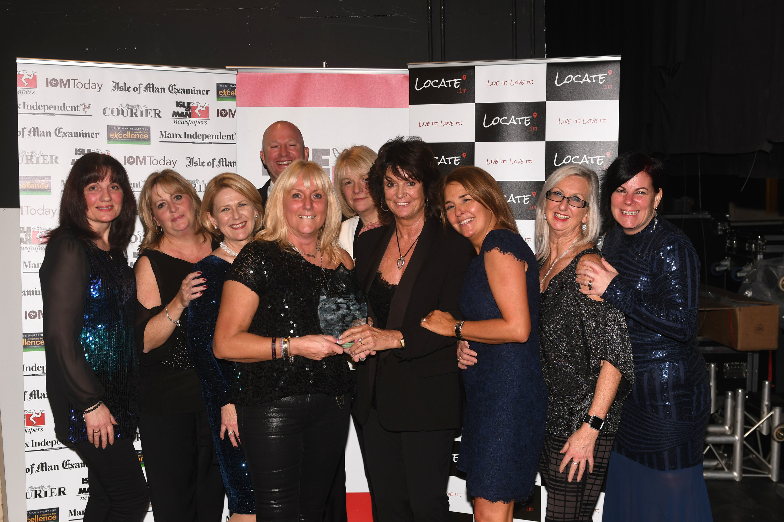 The girls from the Manx Breast Cancer Support Group with their trophy.