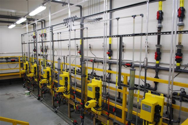"""Six patented, metered feeders provide a total of 1300 gal./day for the plant's treatment train, via 9 different application points. Among other advantages to the all-vacuum liquid feeders, operations management appreciates they """"don't have to worry about a metering pump failing due to air binding."""""""