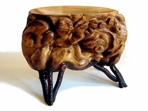 Carved teak bowl with cherry legs.    SALE!   750.00  SOLD