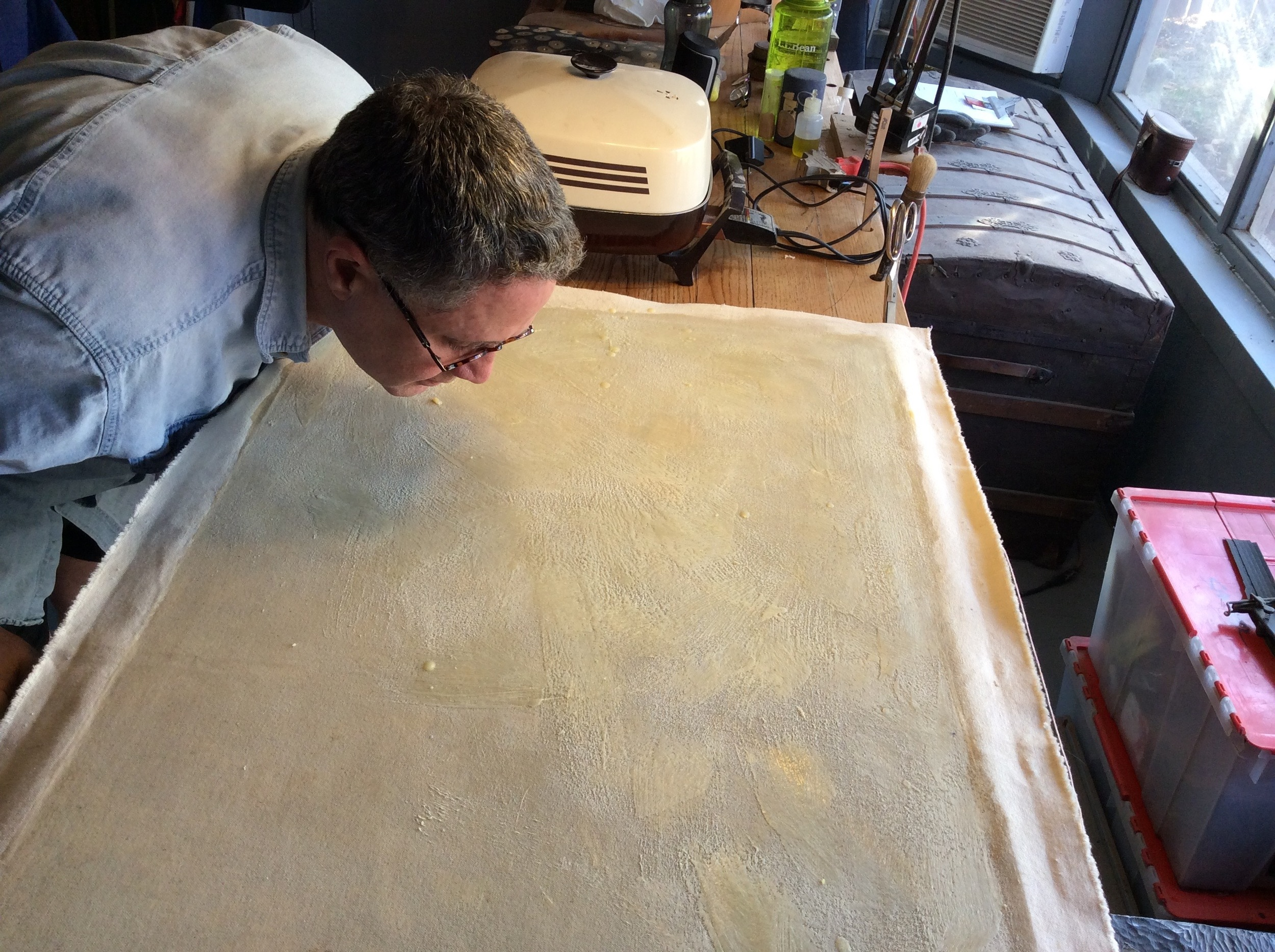 A worn canvas may need to be remounted to a new one. Small and medium size pieces are doable in the studio. Larger pieces need a vacuum table. that process is outsourced.
