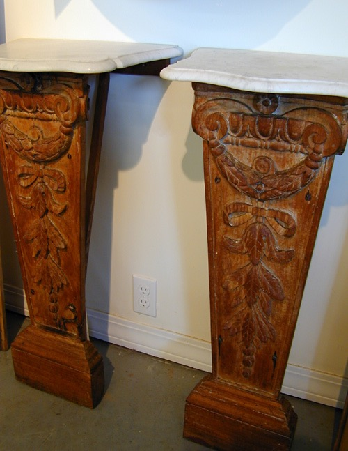 Carved French wall tables with marble tops carefully restored.