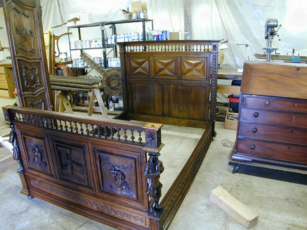 Dutch antique bed. Begun in the 17th C. completed in 18th C. Restored by Cree Studios. Also pictured, Colonial mahogany desk.