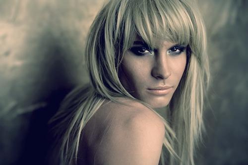 blond transvestite smiles at camera