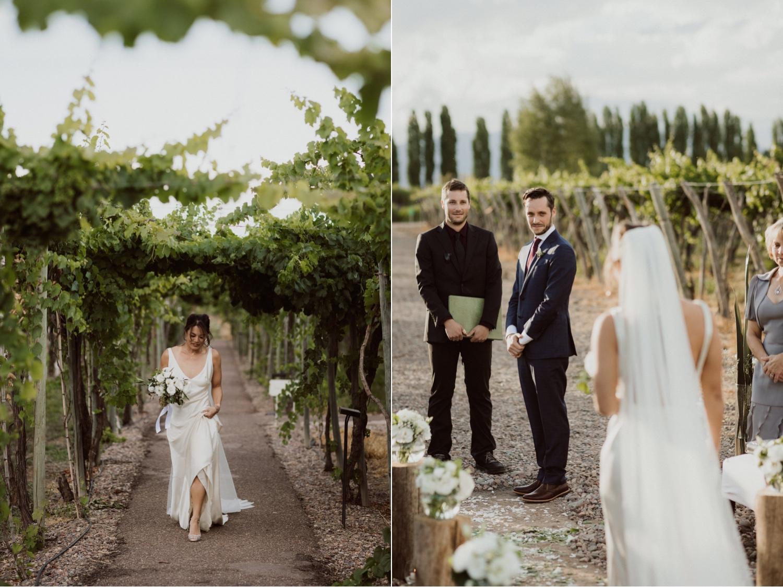 049_at_bride_walking_down_aisle_looking_groom.jpg
