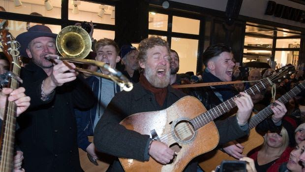 Glen Hansard of The Frames busking on Grafton Street on Christmas Eve.Photograph: Dave Meehan