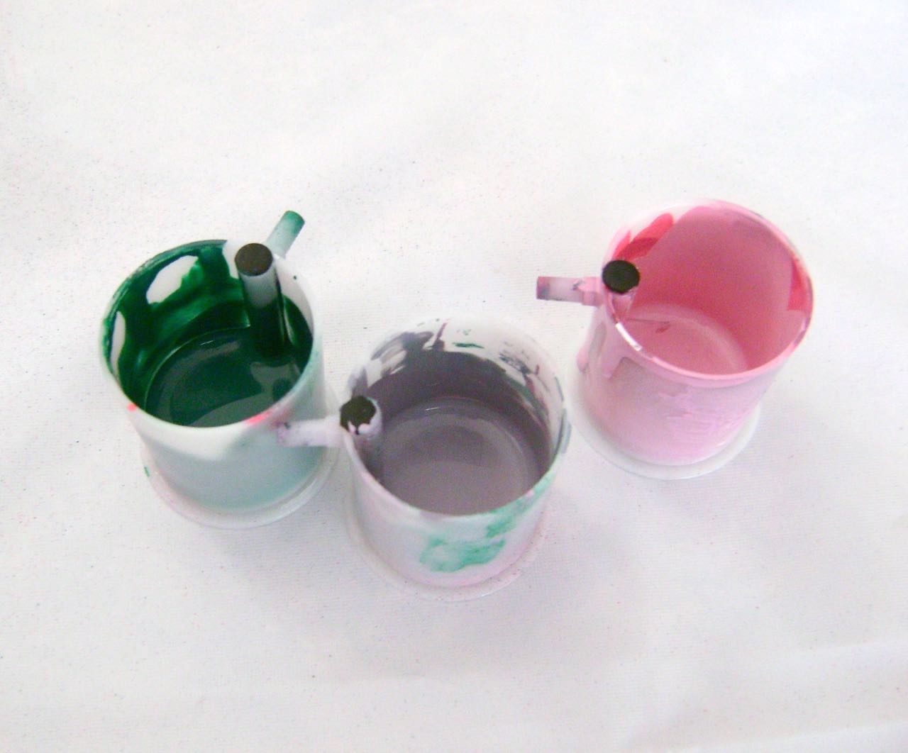 step 10 - Fill paint cups with the three colors.  Airbrush 1/3 of the hearts on both sides with the green blend, 1/3 with the pink blend and 1/3 with the mauve color.  When the paint is dry, very lightly dust the green hearts with pink.
