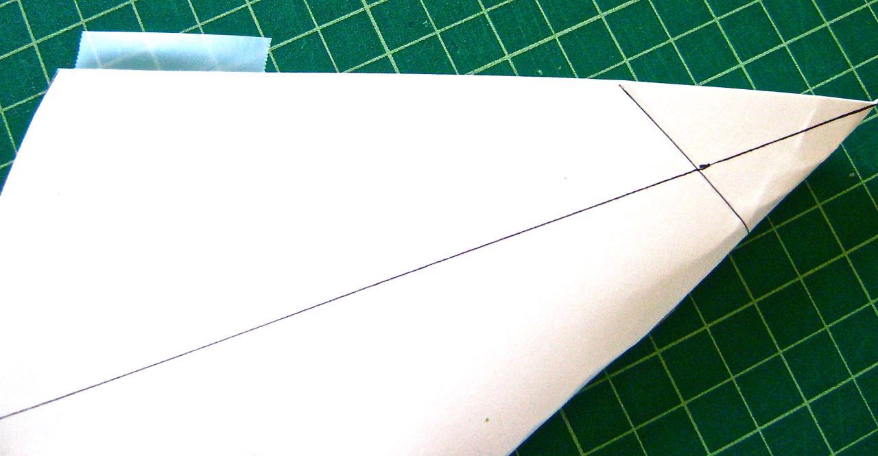 step 3 - Connect the back edges by placing pieces of transparent scotch tape along one back edge.  Match the two edges and fold the tape over to catch the second edge.