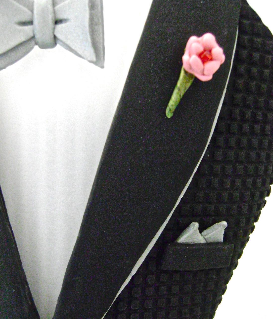 step 16 - Glue the bow tie in the center of the vellum collars with E6000. Also glue a small red bead in the center of the flower.