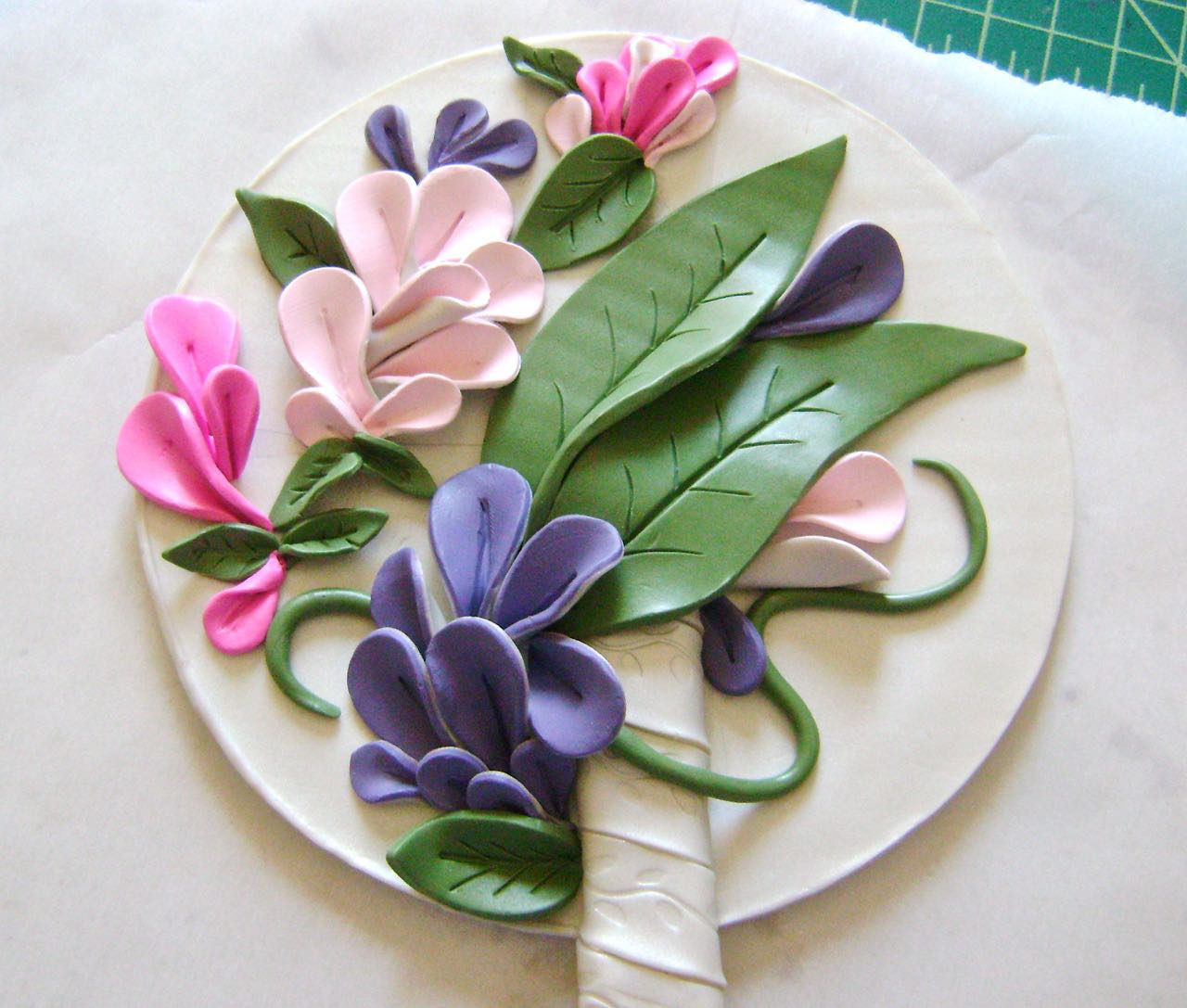 step 14 - Arrange the petals and leaves surrounding the handle and scattered about the rest of the base.