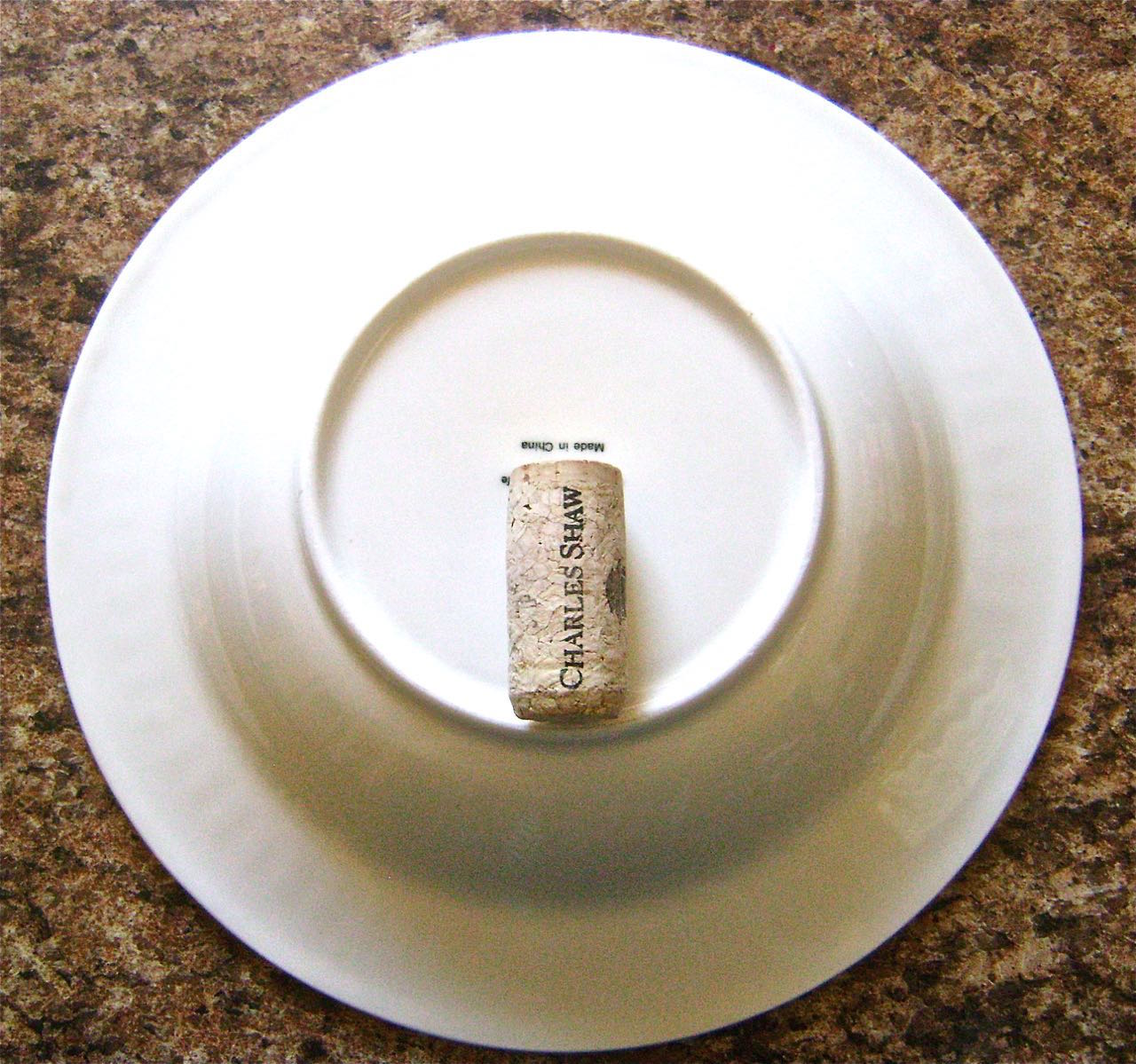 """step 7 - Place a shallow 9"""" soup bowl on the work surface. Set a wine cork in the vertical center."""