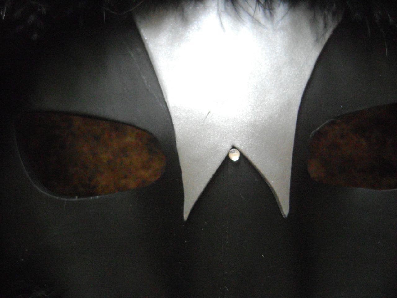"""step 12 - Using a hot fix rhinestone applicator, apply the small rhinestones starting at the center point of the silver clay. Add two below it, then keep adding rows following the design in the photo. The last rhinestone should be about .50"""" up from the bottom of the mask. Add rhinestones across the tops of the eyes."""