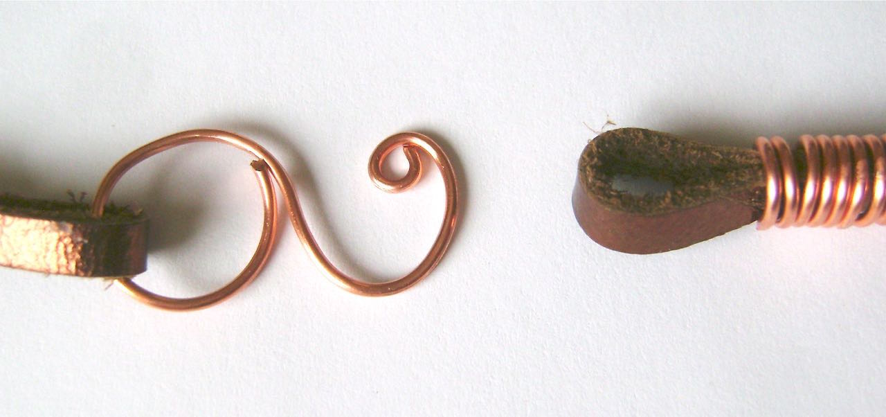 """step 13 - Create an """"S"""" shape with a piece of wire by smoothing one end around a magic marker or other round tool and the other piece of wire around a smaller tool. Close the curve in the larger end. Curl the end wire of the smaller end. with round nose pliers. To fasten the necklace, slip the curled end of the wire through the loop in the leather cord."""