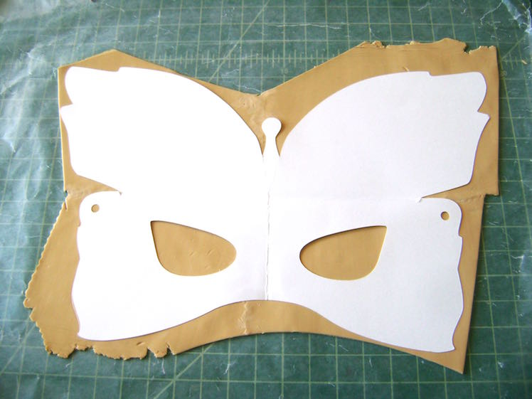 step 5 - Place the template over the clay.  With a craft knife cut out the template shape. Set it aside.