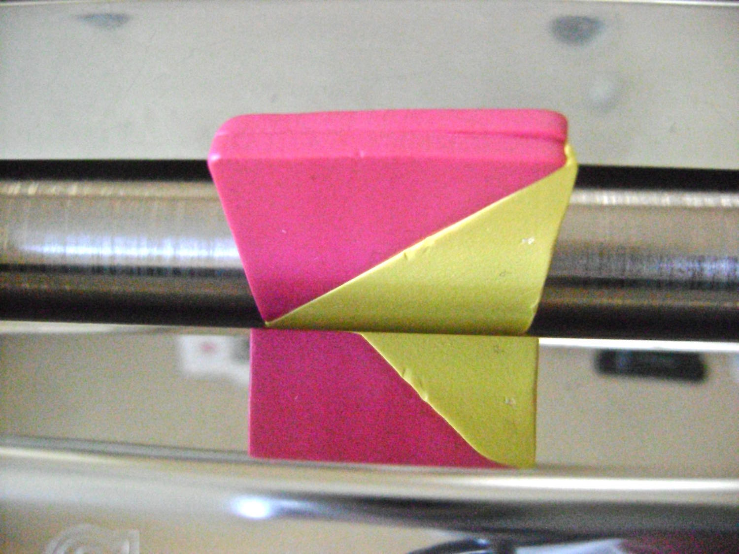 step 3 - Feed the square into the machine on the #1 setting. Fold the piece with the top and bottom edges aligned. Feed it through the machine with the folded edge first. Continue folding and feeding the piece in the same direction 10 times or more until the colors smoothly blend.