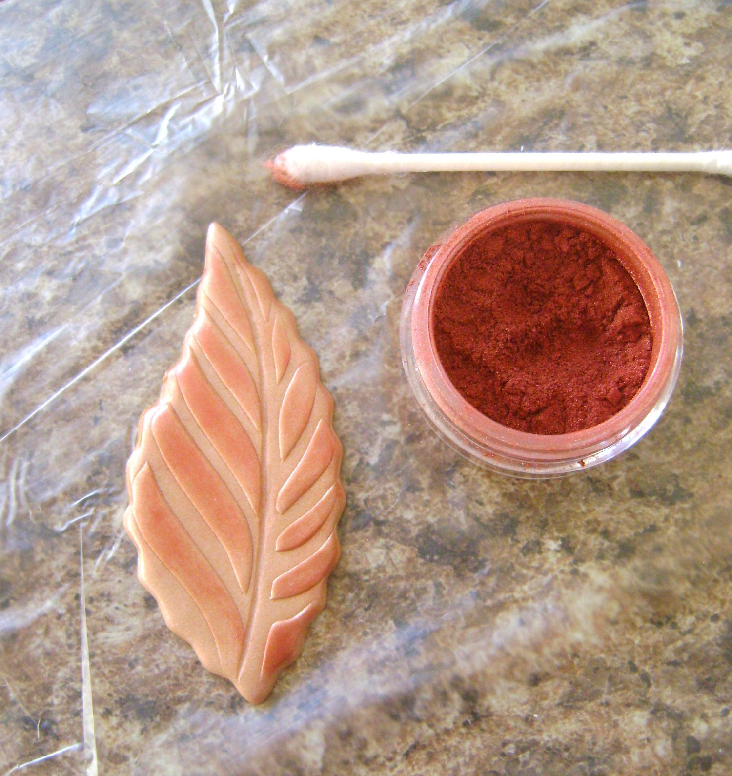 step 10 - Use a makeup brush, Q-tip, or thin craft brush to color the leaves with gold, green, and red powder.  If your powder accidentally lands outside the borders, just remove it with a damp, thin paintbrush.  Gently blot the moisture with a paper towel, which will eliminate the moisture.