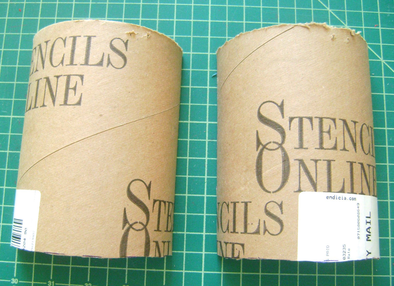 "step 1 - Cut a 4"" round mailing tube down the sides to create two matching 5.50"" tall half containers to act as your mold."