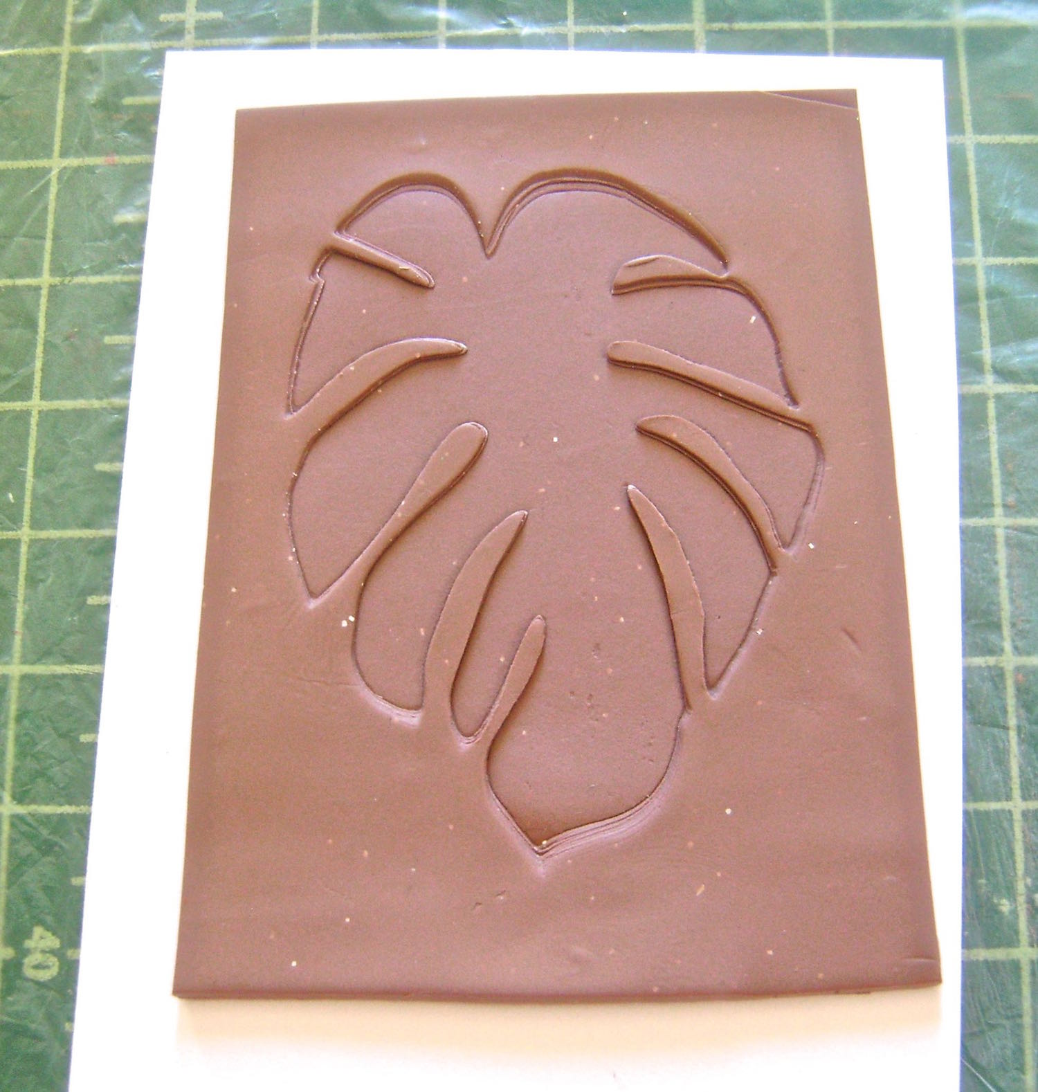 step 7 - Carefully remove the card stock from the clay.  Trim the texture sheet leaving a border all around the image for easy handling.  Bake the clay on pieces of card stock or cardboard at 275 degrees for 30 minutes.  Allow them to cool completely.