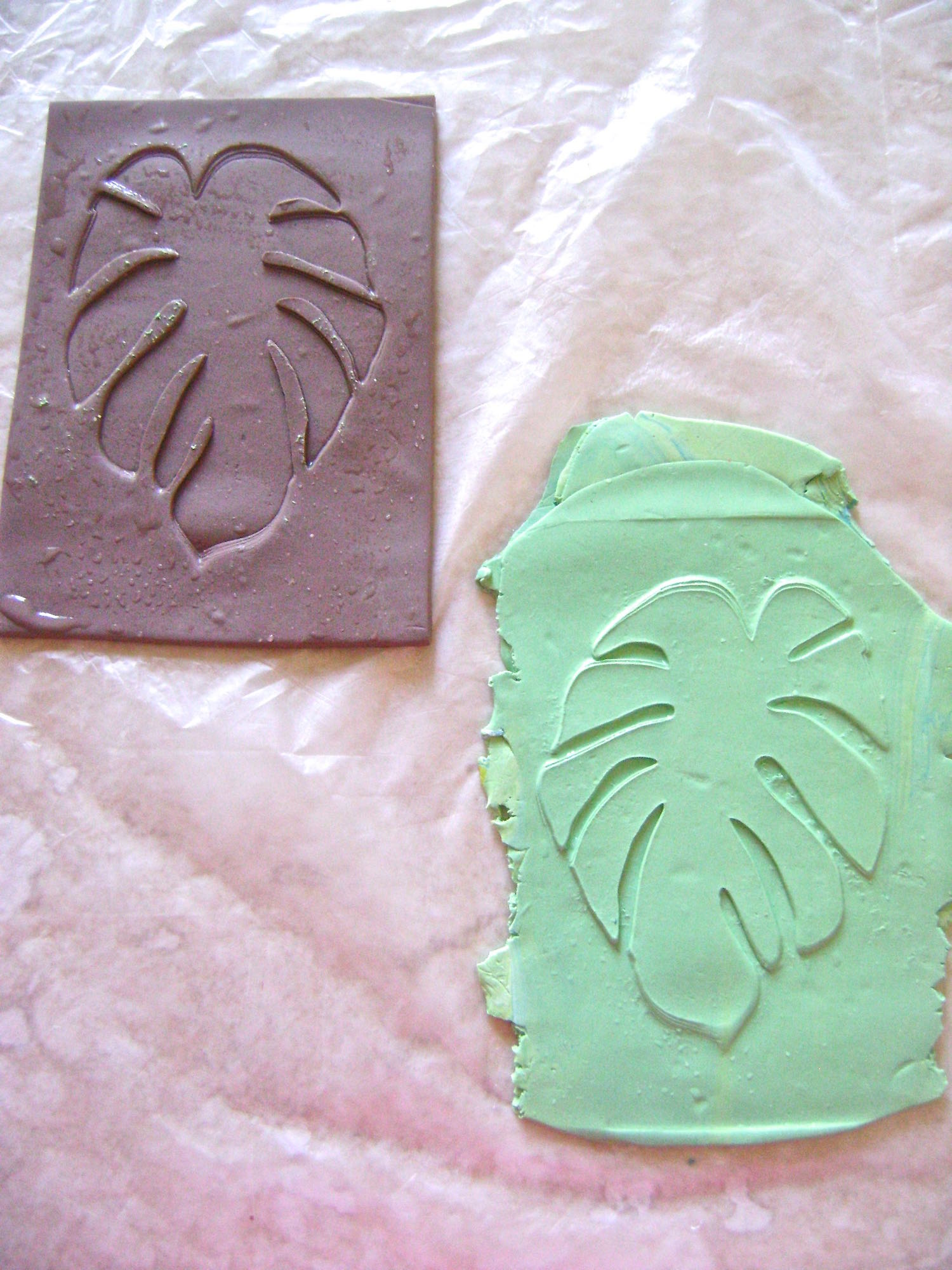 step 8 - Your new texture sheet will create raised images on your project as you see here with the raw green clay.