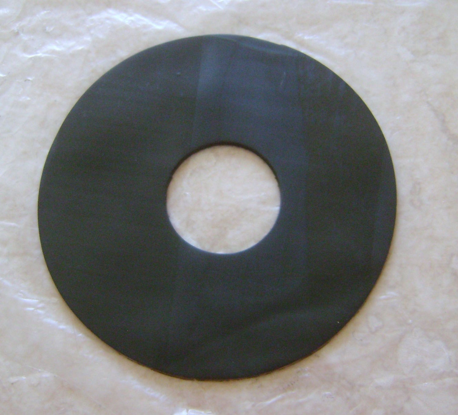 """step 5 - Cut a 4"""" circle from clay. Cut a hole out of the center using the 1.25"""" cutter."""